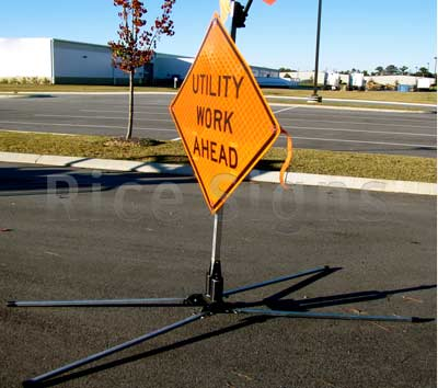 RU5000 sign stand shown with optional Utility Work Ahead roll-up sign.