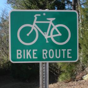 "Our 24""x18"" Bike Route Road Sign shown on a u-channel highway sign post (highway sign post and hardware are sold separately)."
