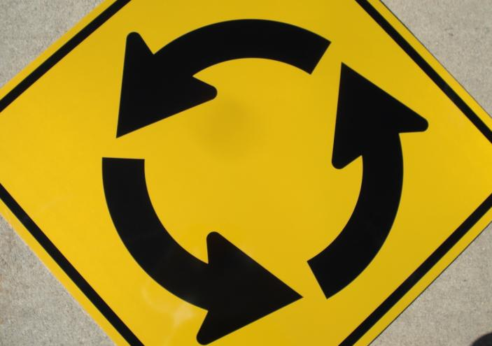 "A photo of our 30""x30"" reflective Circular Intersection traffic sign"