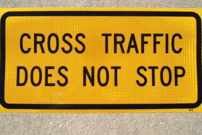 Up-close photo of our Cross Traffic Does Not Stop sign