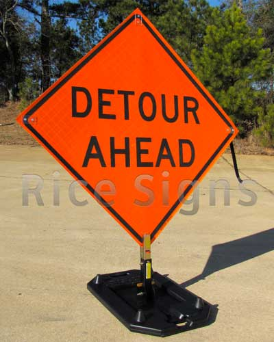 """Reflective Roll-up 36"""" x 36"""" Detour Ahead Sign pictured below with optional RURubber Sign Stand. The Detour Ahead Roll-up Sign provides advance warning of a road closure or a detour."""