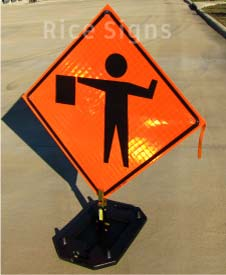 Flagger ahead roll-up sign shown with optional RURubber sign stand.