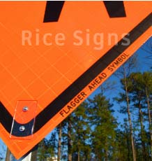 Up-close picture of our flagger ahead roll-up sign.
