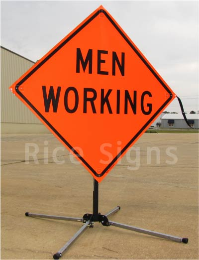 men working words roll up signs