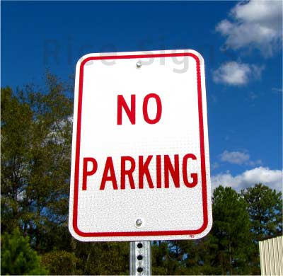 "Pictured: A 12""x18"" No Parking sign with optional portable post and base."