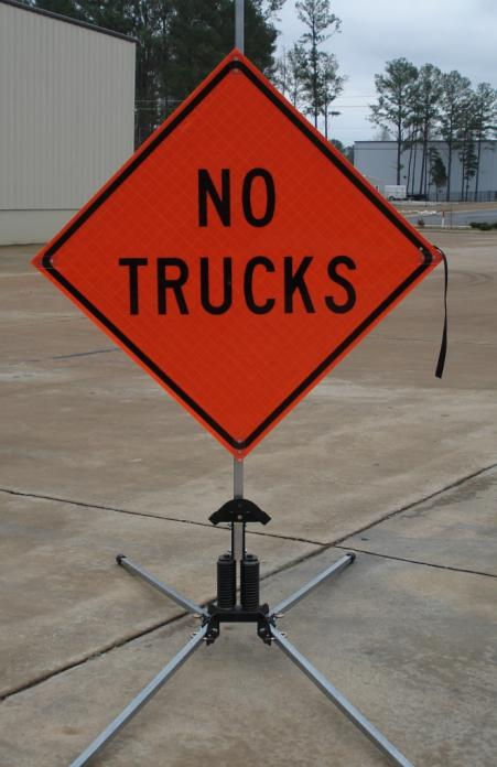 No Trucks Roll-Up Sign shown with our optional RU5000 roll-up sign stand.