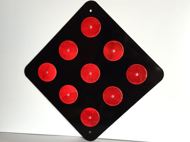Actual picture of our OM4-2 end of road marker with red reflectors on a black background.