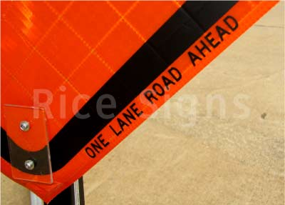 One Lane Road Ahead roll-up sign up-close photo.