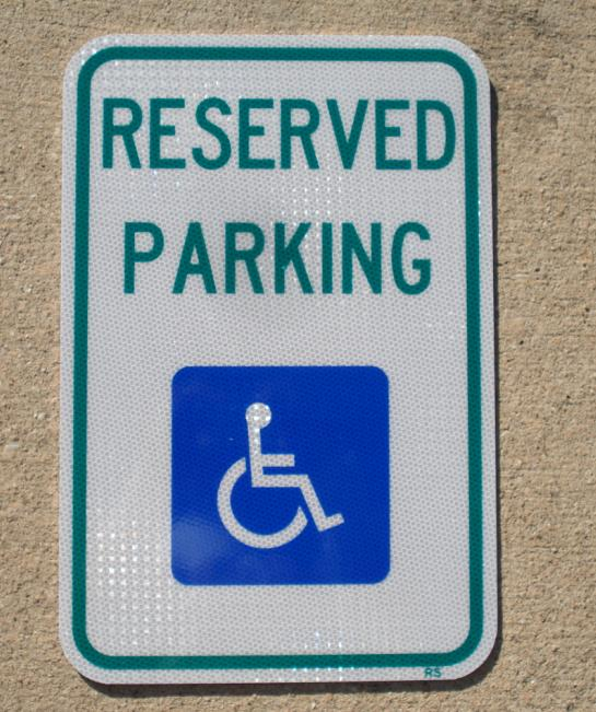 Up-close picture of our reserved handicap parking spot sign