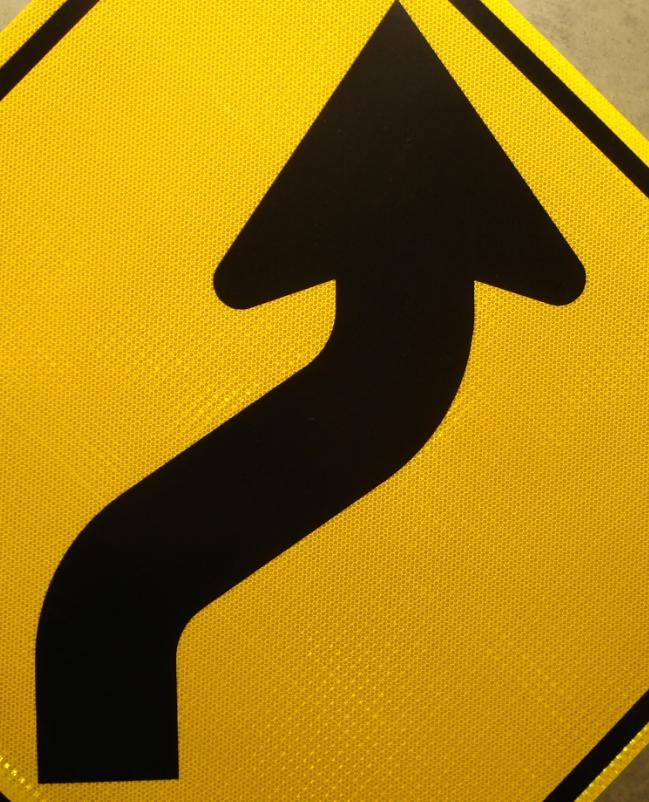 Detailed picture of our reverse curve right highway sign.