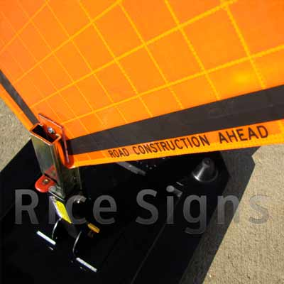 Up-close photo of the Road Construction Ahead sign with optional rubber sign stand (SKU# RURubber).