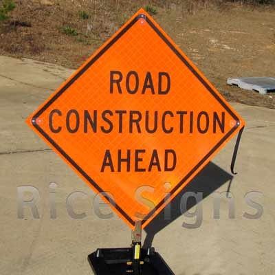 """Reflective Roll-up 36"""" x 36"""" Road Construction Ahead Sign pictured below with optional RURubber Sign Stand."""
