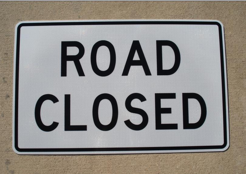 "Our Road Closed sign is shown in the photo. The road closed sign is 48"" wide and 30"" tall."