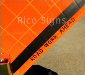 Velcro can be applied around the word AHEAD on our Road Work Ahead roll-up sign. This permits roll-up overlays with different messages to be used to easily change the distance. For example: with the 1000 FT overlay, you could change the message of the sign to Road Work 1000 Ft. This sign features screen printed text in the border, so that when it is rolled up you can see ROAD WORK AHEAD printed in the margin for easy identification.