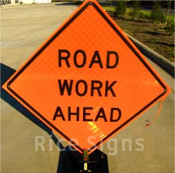 "Pictured: 36""x36"" Reflective Road Work Ahead Roll-Up Sign with Optional Rubber Sign Stand"