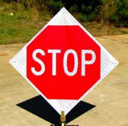 Our Roll-Up Stop Sign is made of Reflective Red and White Roll-Up Vinyl for ultimate portability, while maintaining exceptional visibility at night-time.  The Roll-Up Stop Sign features heavy duty plastic corners and thick fiberglass ribs on the back.  It is compatible with any of our Roll-Up Sign Stands.