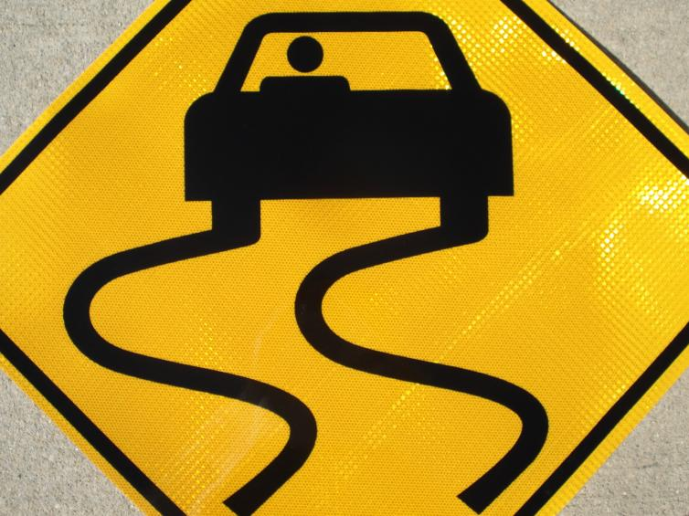 Up-close picture of our Slippery When Wet highway sign.