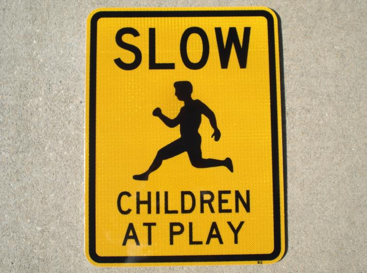 "Pictured: Our 18""x24"" Slow Children At Play street sign. The Slow Children At Play street signs are reflective at night."
