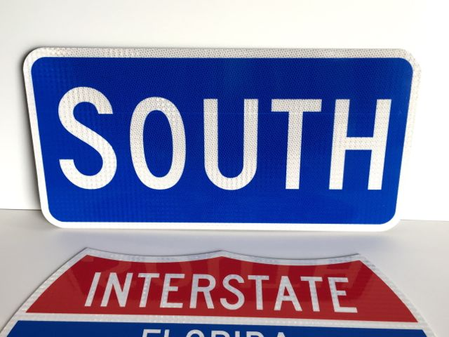 A photo of our South sign paired with an Interstate shield (sold separately).