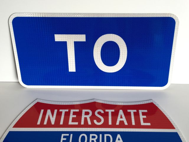 A photo of our To sign paired with an Interstate shield (sold separately).