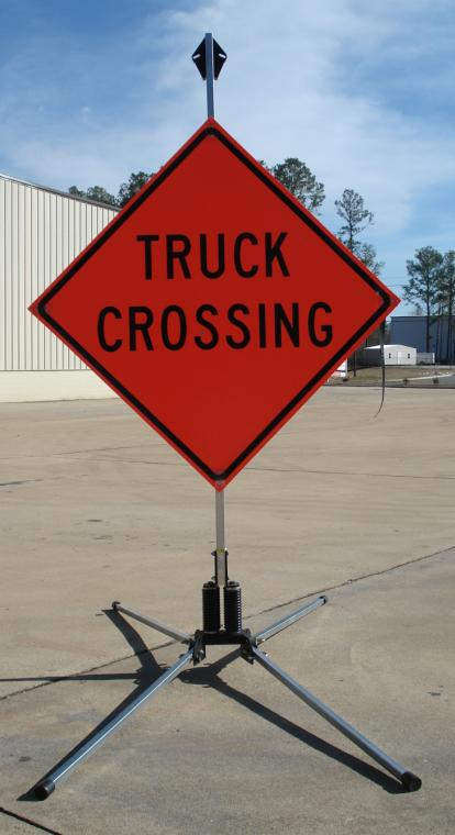 36 Inch Truck Crossing Roll Up Sign, Non Reflective - Shown with our RU5000 roll-up sign stand.
