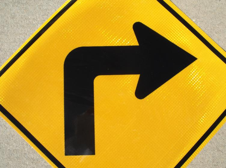 Our Right Turn in road sign is pictured.