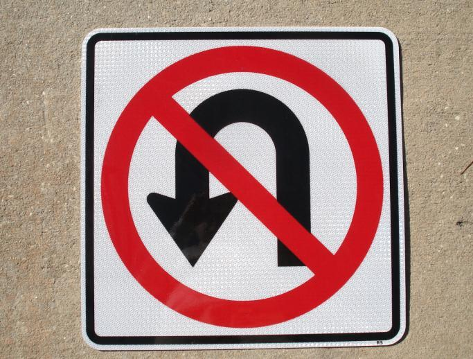 An actual picture of our No U Turns traffic sign.