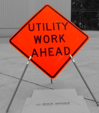 A photo of our Utility Work Ahead sign with optional tripod sign stand (SKU# RU2000)